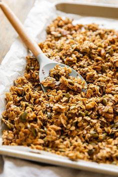 A cozy, fall-inspired Pumpkin Flax Granola recipe that's SO delicious! Made with oats, pumpkin seeds, flax seeds, walnuts, honey, maple syrup, and cinnamon or pumpkin spice, this healthy granola recipe is full of flavor. Add it to yogurt, pudding, smoothies, peanut butter toast, or enjoy it on its own for a great way to start the day!