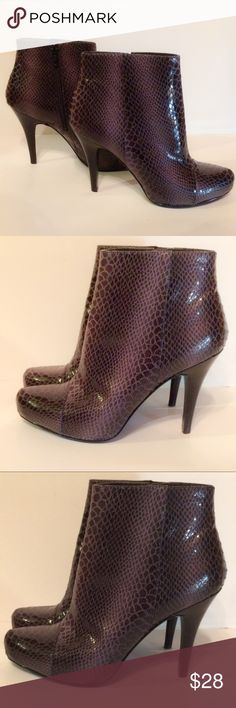 Black  Snake Skin Ankle Boots Faux snake skin ankle boots that zip up the side. Never worn Nine West Shoes Ankle Boots & Booties