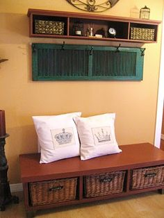 I love that she used an old shutter to make a coat hanger! I want to do this in my entry way!