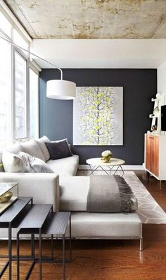 #homedesign #livingroomdecor #inspiration | Photo of a mid-sized contemporary living room with black walls and a wall-mounted tv. — Houzz