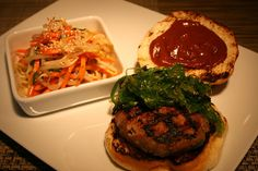 Organic Turkey Burger seasoned with Oyster Sauce, Water Chestnuts, Scallions, Toasted Sesame Oil on a Toasted Komoda Bakery Bun; Homemade Wasabi Ketchup; Seaweed Salad  Bean Sprout and Carrot Slaw; Miso-Sesame Dressing