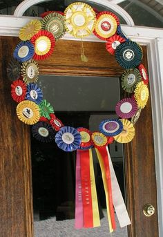 Horse Show Ribbon Wreath. Good idea to use so many ribbons. Wish I had done this.
