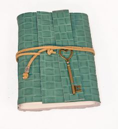 Handcrafted journal. http://www.etsy.com/listing/75491217/green-leather-journal-with-heart-key