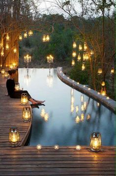 Lovely chiaroscuro pool with glowing lanterns.