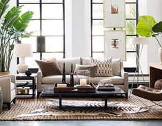 This is a great example of a neutral palette Tribal Pioneer. Leather, linen, sisal, zebra skin, wicker and some greenery. Love it! From William Sonoma Home