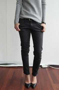 stupid cute slouchy grey sweater tucked into darker charcoal/faded black ankles & black heels