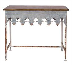 Creative Metal Scalloped Edge Table With Wood Top Zinc Finish DA2068 Memphis - CreativeCo-Op Metal Scalloped Edge Table With Wood Top Zinc Finish DA2068SKU: DA2068Manufacture: CreativeCo-OpCollection: CottageCategory: Home DecorSub-Category: FurnitureMaterial: Metal/WoodColor: Zinc-Type: Console TableShape: RectangleStyle: TraditionalUPC Code: 807472638706Ship By Truck: YesDimensions: 36 L x 16 W x 31.75 H