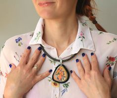 Stone necklace with a hand-painted smiling yellow by SkadiaArt