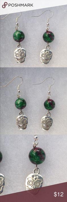 Ruby Zoisite Sugar Skull Earrings These beautiful earrings are made with natural ruby in zoisite and silver tone sugar skull charms. The hooks are sterling silver plated.   All PeaceFrog jewelry items are handmade by me! Take a look through my boutique for more unique creations. PeaceFrog Jewelry Earrings