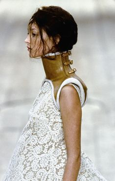 Alexander McQueen . Model Audrey Marnay wears prosthetic leather for Alexander McQueen Show -  s/s 1999 .