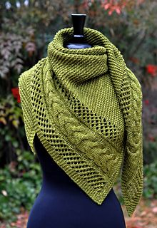 Anisah is a contemporary shawl featuring a textured cable and lace panel surrounded by classic garter stitch. The asymmetrical triangular shaping begins with just a few stitches which then flow into a wide panel composed of a graceful cable flanked by mesh lace. While that panel forms the left edge of the shawl, the remainder of the body is filled with squishy garter goodness. The combination of lace, cables, reverse stockinette and garter stitch knitted in worsted weight makes the texture…