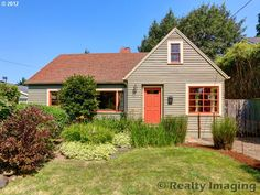 This NE Portland home boasts a beautiful garden with raised beds with a walk score of 85!