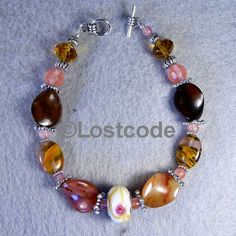 'Wine and Gold Agate Bracelet' is going up for auction at 8pm Mon, Feb 4 with a starting bid of $10.