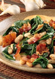 White Beans with Bacon & Garlicky Greens -- All you'll need to season this quick and delicious spinach and white bean side dish recipe is bacon, a bit of garlic and freshly ground black pepper.