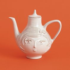odd obsession with ugly but in a charming way teapots
