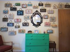 What single lady wouldn't love a wall of purses!  Cute idea... Could be arranged cuter, but the idea is fun.