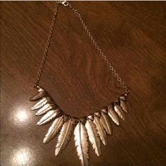 Feather necklace Gold and never worn! Forever 21 Accessories