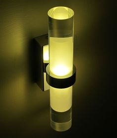 Modern yet functional. The Rome Wall light is an ultra-modern fitting that is ideal for creating ambient light in a room.  The low energy, long life LED chips project light from the top and bottom of the cylinder design for simple and elegant illumination. Mount multiple to the wall to achieve desired effect.
