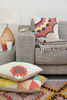 Dan300 | The future is bright ! | Est Magazine  COLORFUL PATTERNED RUG WITH NEUTRAL COUCH