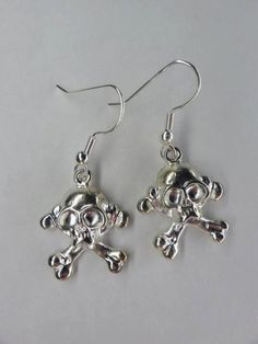 Silver Plated Skull Cross Bones Dangle Earrings by toppytoppy. $9.99, via Etsy.
