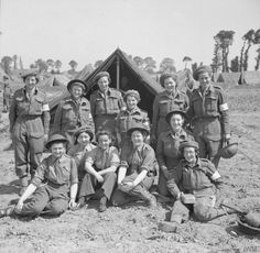 Women of Queen Alexandra's Imperial Military Nursing Service (QAIMS) pose for a group photograph at No 88 General Hospital at Douvres-la-Delivrande, 22 June 1944.