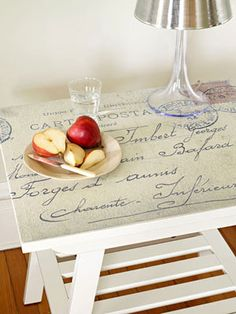Turn a small piece of furniture into a conversation piece by covering the top with a graphic element, like an old letter, postcard