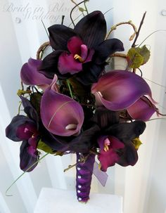 Wedding bouquet of eggplant lilac calla lilies and plum orchids