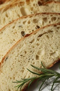 Maori Bread: Rewena: 100 g potato, peeled, sliced thin 165 ml water extra water 165 g strong bread flour 1 tsp liquid honey Dough: 400 g strong bread flour 1 tsp salt 20 g liquid honey 1/4 tsp instant active dried yeast 1 1/2 tbls rosemary, chopped 150 ml water 330 g rewena (above) additional flour for dusting 4—5 ice cubes  to create steam in the oven