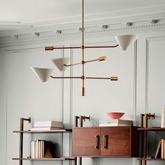 Our Mid-Century Long-Arm Chandelier takes its cues from the task lamp, with arms that spin and rotate so that you can shine the light up or downward. West Elm Chandelier, Mid Century Chandelier, Chandelier In Living Room, Chandelier Lighting, Gold Chandelier, Kitchen Lamps, Kitchen Lighting Fixtures, Globe Pendant Light, Pendant Light Fixtures