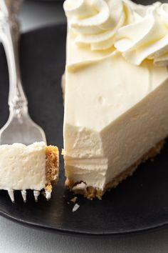 slice of no bake cheesecake on a white plate with a fork taking a bite out