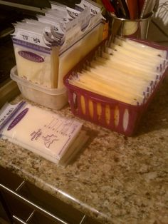 How to store breast milk. I prefer Lansinoh bags. Fill with milk (I typically freeze in bottle size portions - 4oz) fill, slowly close, pushing out any big air bubbles, and freeze laying down on a flat surface (use a small cutting board if needed). Then easily store frozen bags library-card style using the FIFO method (first in, first out). So easy to grab what you need for the baby's next bottle or daycare.