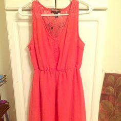 Coral high low summer dress Flowy, high low summer dress! Buttons in the front with a cinched waist, lace on the sleeves and back. Has been worn many times and shows it a bit under the arms. Such a great dress! Forever 21 Dresses High Low