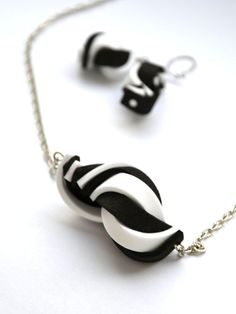 Black and white necklace and earrings made from moosgummi