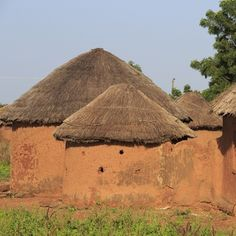 "Uganda The design of the new buildings is heavily influenced by the local vernacular tradition of simple circular huts, with ""adobe"" earth walls and conical thatched roofs."