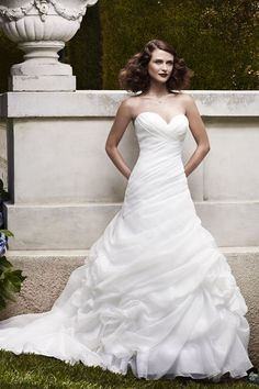 Girlie brides, feast your eyes on this draped organza fit-and-flare with rose-motifs pickups on the skirt. Gown, about $900, by Casablanca Bridal.Check out more gorgeous dresses in our Casablanca Bridal gown gallery!Photo courtesy of designer