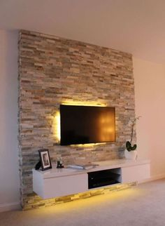 ▷ 1001 + Ideen für Fernsehwand Gestaltungen - Ideen und Tipps tv wall panel stone effects on the wall seinwand stones behind the television subtle led lighting in yellow color shelf under the televisi Feature Wall Living Room, Living Room Tv, Feature Walls, Stone Wall Living Room, Tv Wall Ideas Living Room, Tv Wall Design, House Design, Deco Tv, Tv Wanddekor