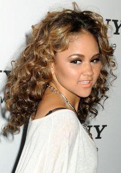 Kat Delunas curly, brunette hairstyle