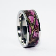 Pink camo wedding band- make a statement with this unique symbol of love. https://www.kharity.com/product/30/Pink-Camo-Ring---Titanium-Wedding-Band