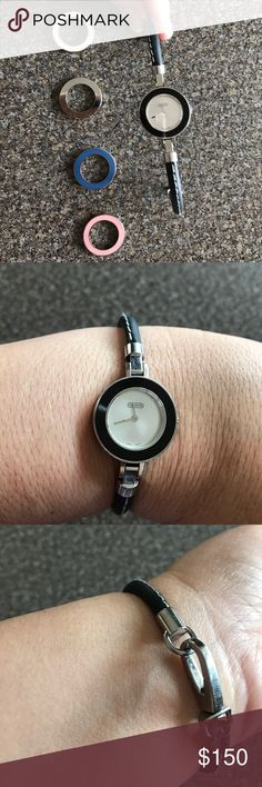Coach Leather Watch Coach Leather Watch with five interchangeable face rings. This Watch is in great condition with very little scratches. The band is made with black leather. Coach Accessories Watches