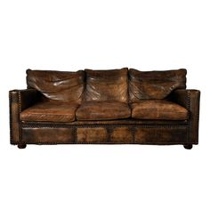 Worn Leather sofa: clean lines, broken-in relaxed look, nail head trim gives it more character.