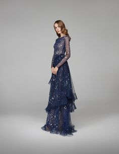 #Stardust #deep #dark #blue #tulle #layered #nighttime #sky #fitted #defined #delicate #long #sleeves #velvet #belt #bow #silhouette #soft #transparency #gown #dynamic #skirt #shimmers #embroidered #sparkling #silver #stars, #glittering #moons #clustered #crystals #constellations #shootingstars #luxurious #glassbeads #gemstones #glamorous #fashion #design #autumnwinter #2018 #eveningwear #hamdaalfahim