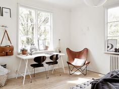 Simple but smart working space in bedroom: Arne Jacobsen 'Ant' chairs & 'Butterfly' leather lounge chair