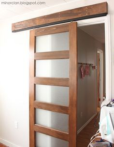 DIY Sliding Door (how to get around the expensive hardware!). Used this for inspiration for our bathroom door!