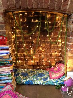 Life Unstyled: Fireplace Filled! reading nook in unused fireplace