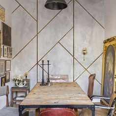 A unique take on the ever popular concrete trend, Coordone's La Coupole Mural features geometric concrete triangular tiles in a variety of sizes that dissect the design, copper or brass grouting outlines these tiles. Although concrete is traditionally