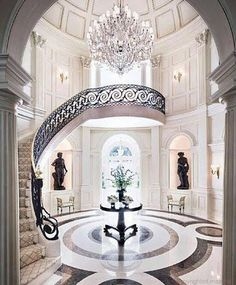 Opulent entry staircase with marbel floors