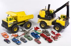 Lot 422: Tonka and Small Toy Truck and Car Assortment; Including two Tonka trucks with plastic wheels, Tootsietoy metal and plastic vehicles, a Corgi truck and a Hubley airplane
