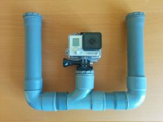 A very simple underwater mount for GoPro cameras made entirely out of PVC tubes.Materials of PVC tube PVC PVC end capsPVC-U AdhesiveGoPro mount plate was made out of PVC tube heated and bent into shape. Gopro Diy, Pvc Tube, Gopro Accessories, Gopro Camera, Surf, Photography Editing, Deep Sea, Videography, Videos