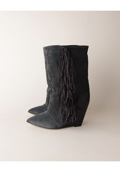 Stuffed denim in a pair of Isabel Marant fringed boots. #HighWaisted #IsabelMarant #Redone
