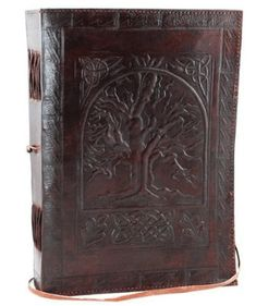 Tree of Life Leather Journal, A beautiful journal that conveys a sense of age and mysticism, the large Tree of Life leather blank book is a beautiful journal whose cover features the hand tooled design of the Tree of Life. Leather Notebook, Leather Books, Blank Book Of Shadows, Journal En Cuir, Leather Bound Journal, Celtic Tree Of Life, Book Journal, Life Journal, Journal Diary